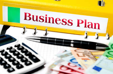 Business plan folder with office tools photo
