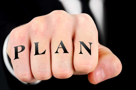 Plan word on business man fist photo