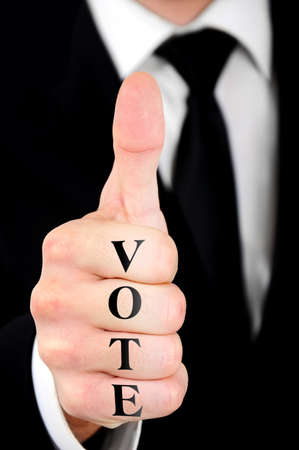 Businessman showing ok sign wih vote word photo