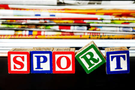Sport word near many newspapers photo