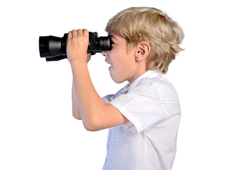 isolated young boy with binoculars photo