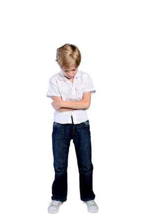 upset young boy on white background photo