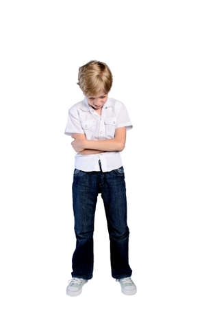 upset young boy on white background photo