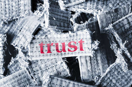 Trust word on material pieces photo