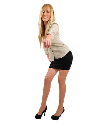 Isolated young business woman pointing you photo