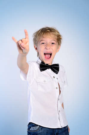 Young rocker boy on blue background photo