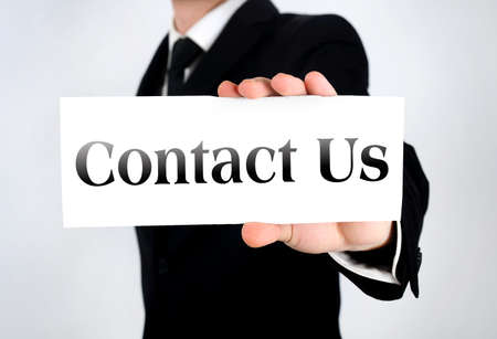 Business man showing contact card  photo