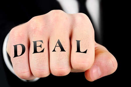 Deal word on business man fist photo