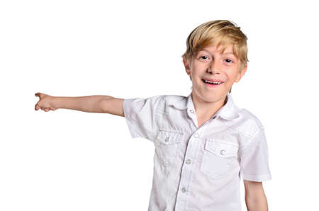 isolated young boy pointing back