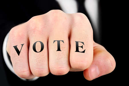 Vote word on business man fist photo