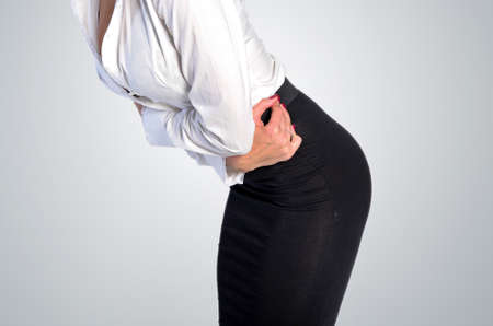 Isolated young business woman stomach ache photo