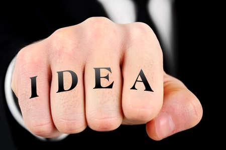 Idea word on business man fist photo