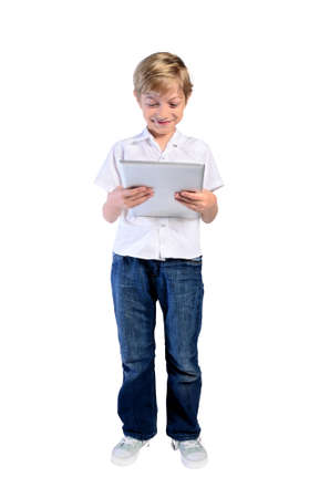 rightful: young child boy with tablet on white background Stock Photo
