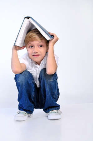Young child boy hide with book  photo