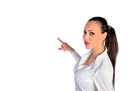 indication: young woman indication something on white background Stock Photo