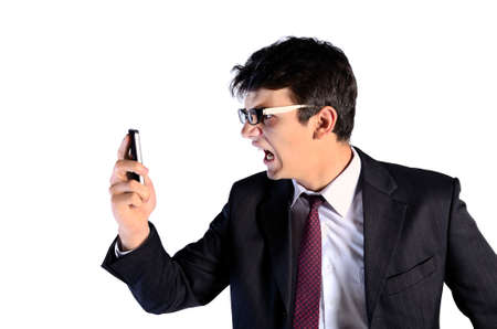 Young business man furious on white background photo
