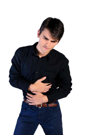 constipation symptom: young man in casual clothes on white background Stock Photo