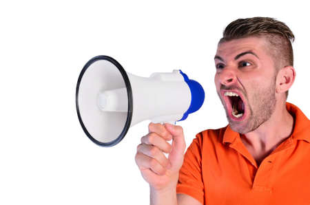 young man screaming aggressive at loudspeaker on white background photo