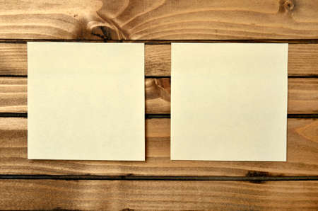 twp blank postnote on wood background photo
