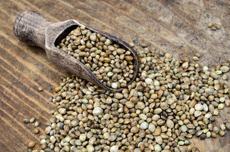 hemp seed on wooden table with scoop Stock Photo