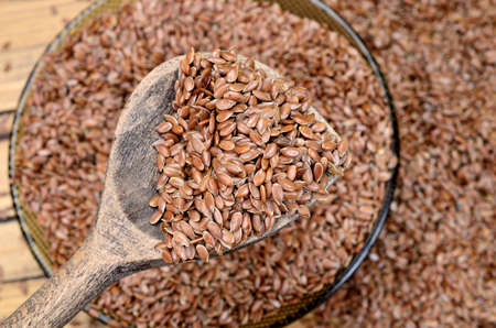 flax seed on wooden table Stock Photo
