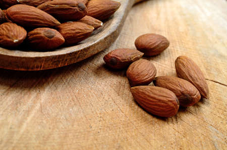 almond on wooden table