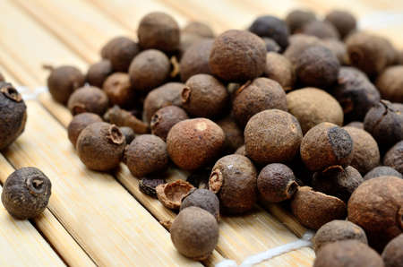 allspice on wooden table Stock Photo