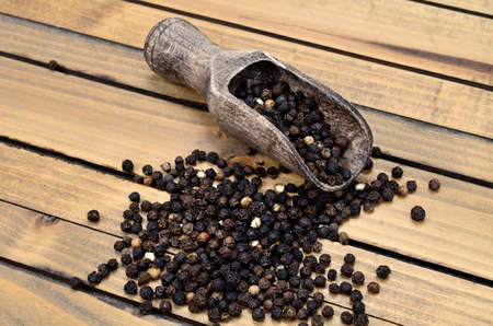 peppercorn on wooden table Stock Photo