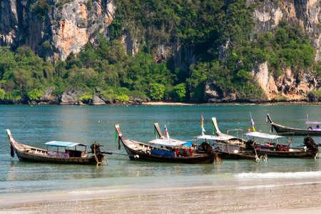 tranfer: Long tail boats on the beach in Krabi Stock Photo