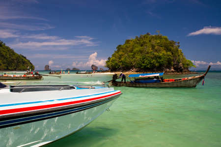 tranfer: Motor boat at anchor in a lagoon in Thailand
