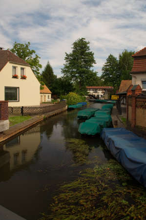 residential idyll: Channel with many boats in the Spreewald