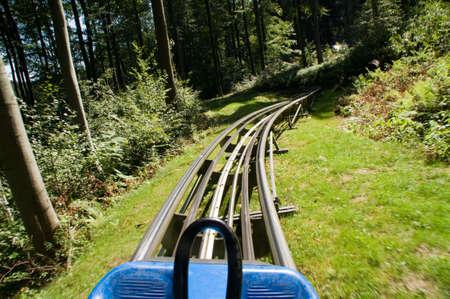 slideshow: Summer toboggan run in the forest Stock Photo