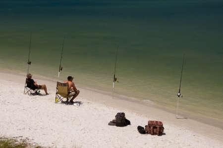 fishing rods: Beach fishing rods anglers waiting