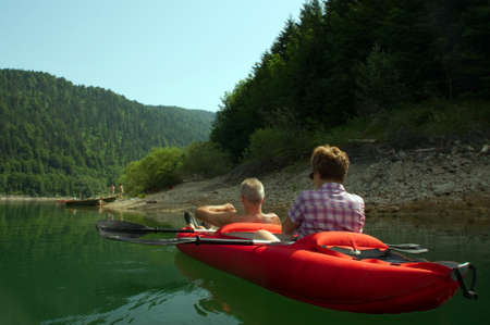 rowing boat: Kayak rowing boat man woman watersports