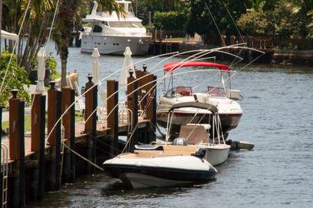 motor boats: Speedboat Pier Harbour three motor boats Stock Photo