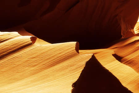 lower antelope: Golden, sand stone in lower Antelope Canyon in the Navajo Reservation near Page, Arizona USA Stock Photo