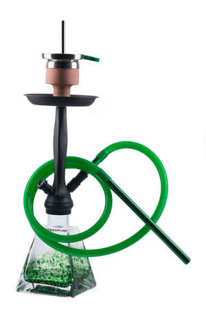 Modern green hookah isolated on white background. Eastern smokable water pipe smoking on white background. greenhookah with black rubber tube and green flask isolated on white background. Stock Photo