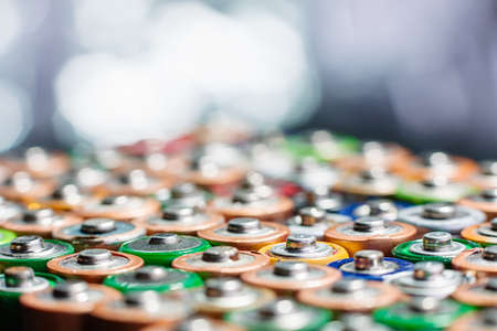 old mercury: Energy abstract background of colorful batteries. Close up top view on rows of selection of AA batteries. Alkaline battery aa size. Several batteries are next to each other. Many aa batteries.
