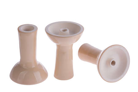 reversed: hookah bowl for tobacco shisha three ceramic products, ceramic products arranged in a row, three beige glazed vessels, one pottery is right and second is reversed and third lays