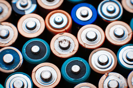 old mercury: Close up top view on rows of selection of AA batteries energy abstract background of colorful batteries alkaline battery aa size. Several batteries are next to each other. Many aa batteries.
