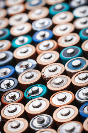 old mercury: Close up top view on rows of selection of AA batteries energy abstract background of colorful batteries. Alkaline battery aa size. Several batteries are next to each other. Many aa batteries. Stock Photo