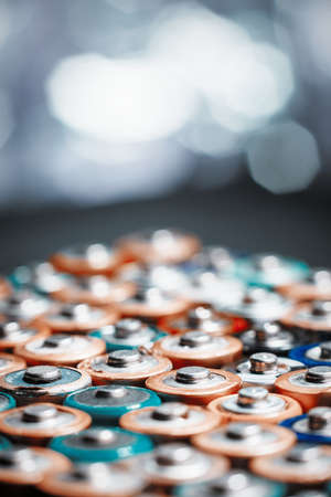 Close up top view on blurred rows of selection of AA batteries energy abstract background of colorful batteries. Alkaline battery aa size. Several batteries are next to each other. Many aa batteries.