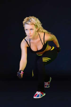 Girl athlete posing on black background Zdjęcie Seryjne
