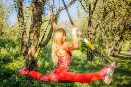 Outdoor exercises on fitness straps
