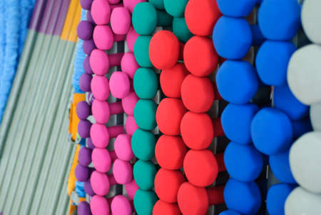 A lot of colorful dumbbell on stand Standard-Bild