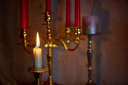 Candles to a beautiful candlestick.