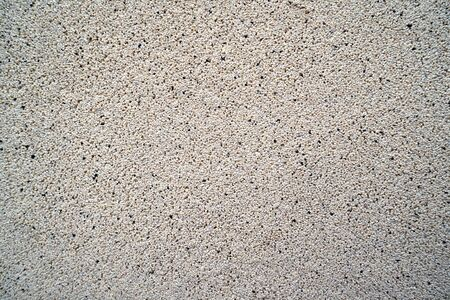 Surface and texture of fine mix size gravel gray wall.