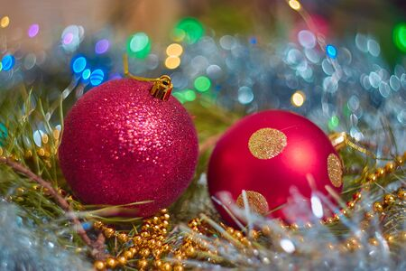 Christmas decorations, red ball in sequins, on the branch of a pine Stock Photo