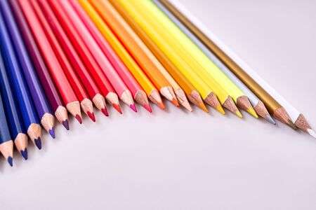 colored pencils arranged on a white background.Colored pencils have many colors arranged together Banco de Imagens