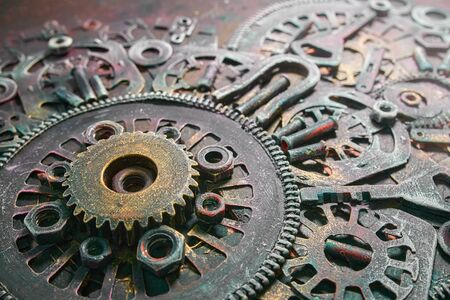 Machine gear, metal cogwheels, nuts and bolts and keys.Gears cogs motion metal industrial background.Selective focus. 版權商用圖片 - 141662603